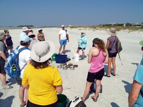 MAREX's Dodie Sanders brief's the workshop teachers during a field trip to Tybee Island.